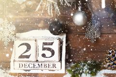 Christmas Frame from Snowy Xmas tree branches and Wooden Calenda. Christmas Frame from Snowy Xmas tree branches, Wooden Block Calendar with 25 December Date and stock images