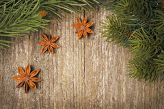 Christmas frame (spruce branches and star anise) on the old wood Stock Images