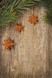 Christmas frame (spruce branches and star anise) on the old wood Royalty Free Stock Images