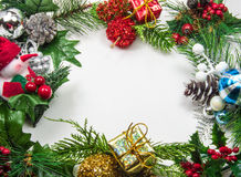 Christmas Frame. Christmas theme frame with fir, pinecones, berries and mistletoe isolated on white background Royalty Free Stock Photos