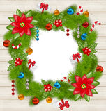 Christmas frame with traditional elements on wooden background Stock Images