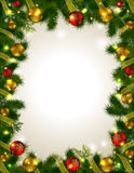 Christmas frame. Frame with Christmas tree branches. Place for inscription surrounded the tree. Christmas twigs decorated with festive outfits Stock Image