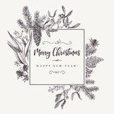 Christmas frame in vintage style. Christmas holiday frame  with pine branches, mistletoe, fern. Black and white. Engraving. Vector design elements isolated on Royalty Free Stock Photo