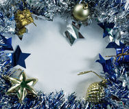 Christmas frame on white photo. Blue ribbon wreath with place for text. Stock Photos