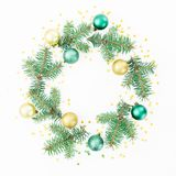 Christmas frame of winter trees, golden balls and confetti on white background. Flat lay, top view Royalty Free Stock Image