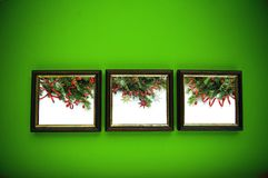 Christmas frames on green wall Royalty Free Stock Images