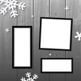 Christmas frames. Vector Christmas blank frames set on wooden wall, snowflakes Stock Photography