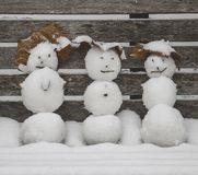 Cute mini snowmen on snowy winter day royalty free stock images