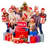 Christmas friends women , men with shopping bag and gift box. Stock Images