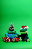 Christmas frog with gifts still life Royalty Free Stock Image