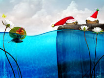 Christmas frogs. Two toads sit on a pilon wearing christmas santa hats as a little turtle swims toward them with a christmas present.  Whimsical gift giving Stock Photos