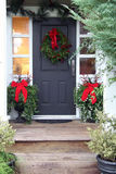 Christmas front door. Front door with a Christmas wreath and bows Stock Images