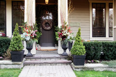 Christmas front door. Front door with a Christmas wreath and bows Stock Photo