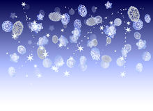 Christmas frozen background with snowflakes, stars and flying snow. Blue and white winter background with glowing stars, snowballs and snowflakes Stock Image