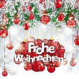 Christmas  Frozen Green Fir Twigs Red Baubles Frohe Weihnachten. German text Frohe Weihnachten, translate Merry Christmas Stock Photography