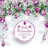 Christmas  Frozen Green Twigs Purple Baubles Frohe Weihnachten. German text Frohe Weihnachten, translate Merry Christmas Stock Photo