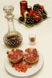Christmas Fruit. Grenade, candels and liquor for a Chrismas evening Royalty Free Stock Photography