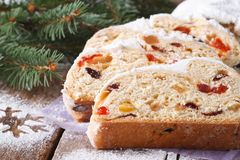 Christmas fruit bread Stollen close-up, horizontal, rustic style Stock Image