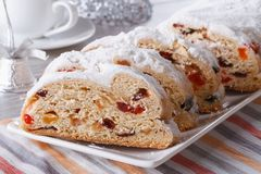 Christmas fruit bread Stollen closeup on a plate. horizontal Royalty Free Stock Images