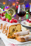 Christmas fruit cake and Christmas decoration on a rustic wooden table Stock Photo