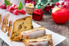 Christmas fruit cake and Christmas decoration on a rustic wooden table Stock Image