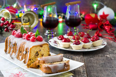 Christmas fruit cake and Christmas decoration on a rustic wooden table Stock Photos