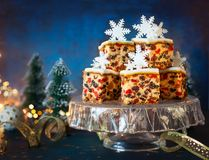 Christmas fruit cake. With icing and sugar snowflakes on the glass cake stand royalty free stock images