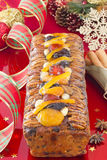 Christmas Fruit-cake with festive decoration Stock Images