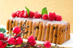 Christmas fruit cake on golden and brilliant background Stock Photos