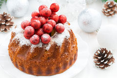 Christmas fruit cake on a plate and decorations Stock Photo