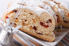 Christmas fruit cake Stollen sliced macro horizontal Royalty Free Stock Image