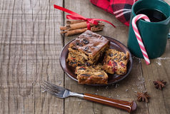 Christmas fruit cake and tea over rustic wooden background Stock Image
