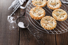 Christmas fruit mince pies over rustic wooden background Royalty Free Stock Images
