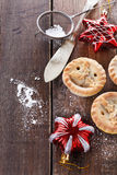 Christmas fruit mince pies over rustic wooden background Royalty Free Stock Image