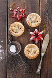 Christmas fruit mince pies over rustic wooden background Stock Image