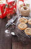 Christmas fruit mince pies over rustic wooden background Stock Photos