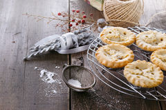 Christmas fruit mince pies over rustic wooden background Stock Images