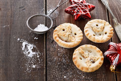Christmas fruit mince pies over rustic wooden background Stock Photo