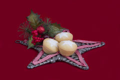 Christmas Fruit Mince Pies on Star on Red Stock Images