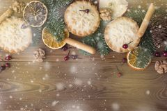 Christmas Fruit mince tarts. Fir branches and christmas decorations. Rustic wooden background stock images