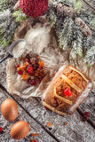 Christmas fruit traditional loaf or cake with ingredients and christmas decoration on wooden table Stock Image