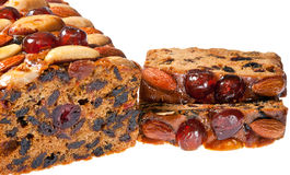 Christmas fruitcake slices on white background. Royalty Free Stock Photo