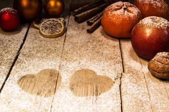 Christmas fruits and sugar hearts Royalty Free Stock Photo