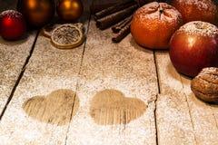 Christmas fruits and sugar hearts Royalty Free Stock Photo