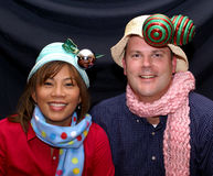 Christmas fun. Caucasian and Philippino married couple posing in fun Christmas hats and scarves Royalty Free Stock Image