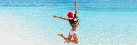 Christmas fun beach banner panorama background. Christmas fun beach banner panorama blue ocean water background. Christmas vacation paradise holiday. Bikini royalty free stock photos