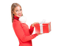 Christmas fun blond. Portrait of a beautiful blond christmas woman with gift box Royalty Free Stock Photography