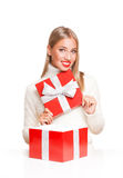 Christmas fun blond. Portrait of a beautiful blond christmas woman with gift box Royalty Free Stock Photos