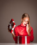 Christmas fun blond. Portrait of a beautiful blond christmas woman with gift box Stock Images