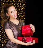 Christmas fun with brunette beauty. Royalty Free Stock Image